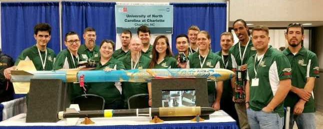 Adams stands with her teammates at the UNC Charlotte's 49er Rocketry Club booth at the 2018 NASA Student Launch Initiative.