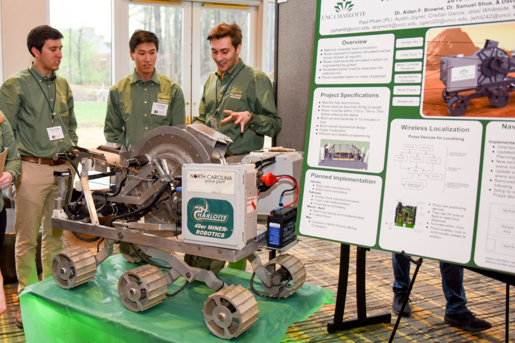 The UNC Charlotte 49er Miner Robotics Team present their robotic mining machine at the 2019 NC Space Symposium.