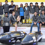 Duke Electric Vehicles students with their award-winning vehicles