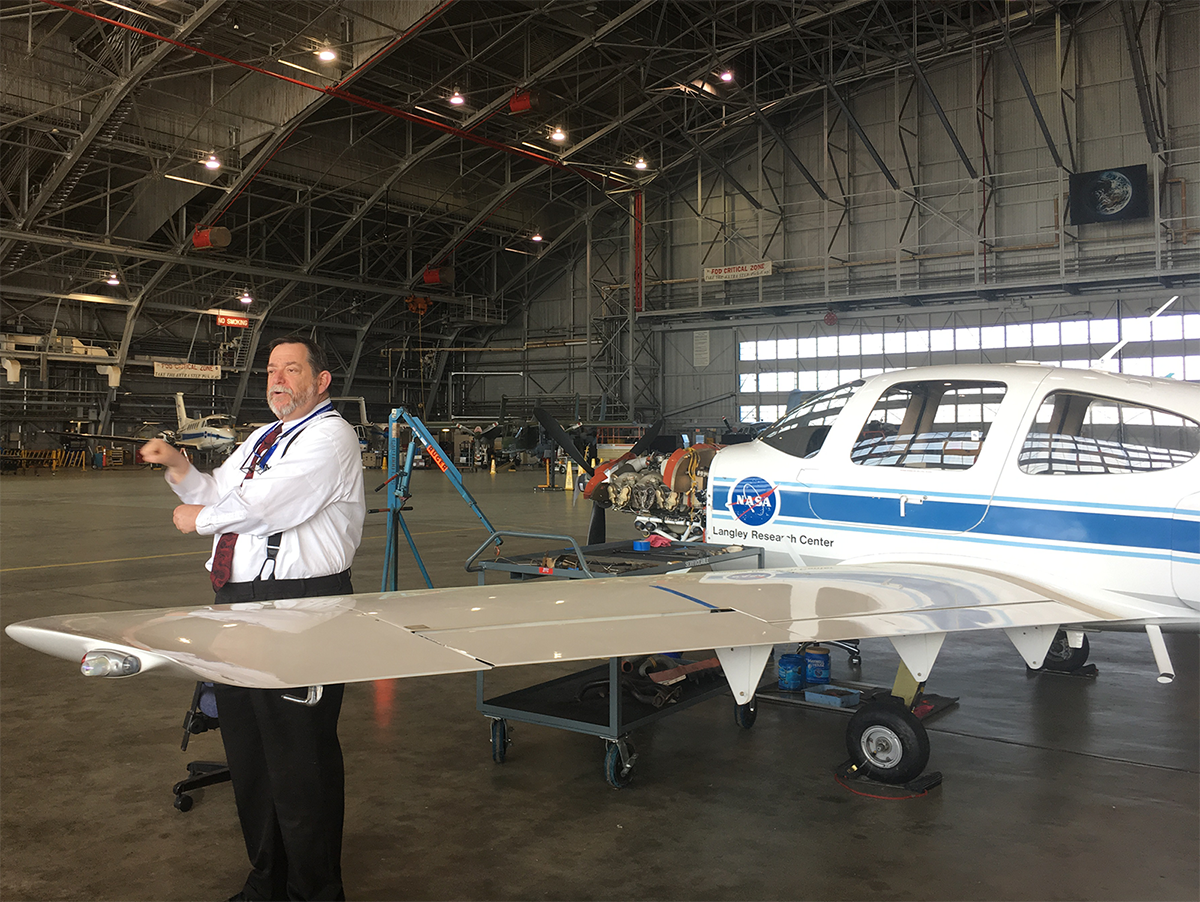 A NASA Langley Research Center education specialist explains a research aircraft