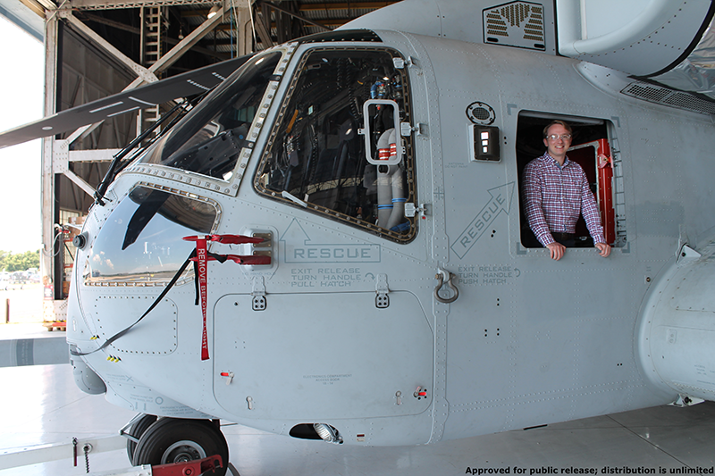 Lauer leans out of the CH53K King Stallion helicopter he is currently working on at Sikorsky Aircraft.