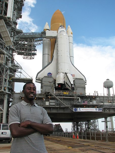 Keith Parker stops in front of the NASA space shuttle at NASA Kennedy Space Center in Florida.