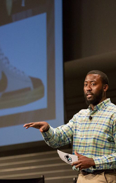 Parker delivers a presentation during his time as a program manager at Nike, Inc.