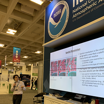Theurer presents at the NOAA booth at the AGU Fall Meeting in 2019.