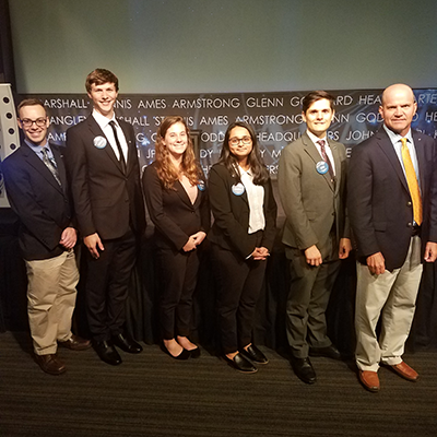 Theurer poses with his NASA DEVELOP internship team and science advisor after presenting their work at the Annual Earth Science Application Showcase (AESAS) in 2018.