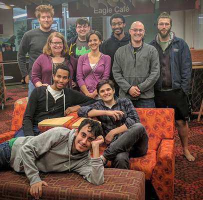 Ryan Theurer and the Unacceptable Risks team pose with their faculty advisor, Julie Hoover, before getting to work on their High Altitude Student Platform project in 2016.