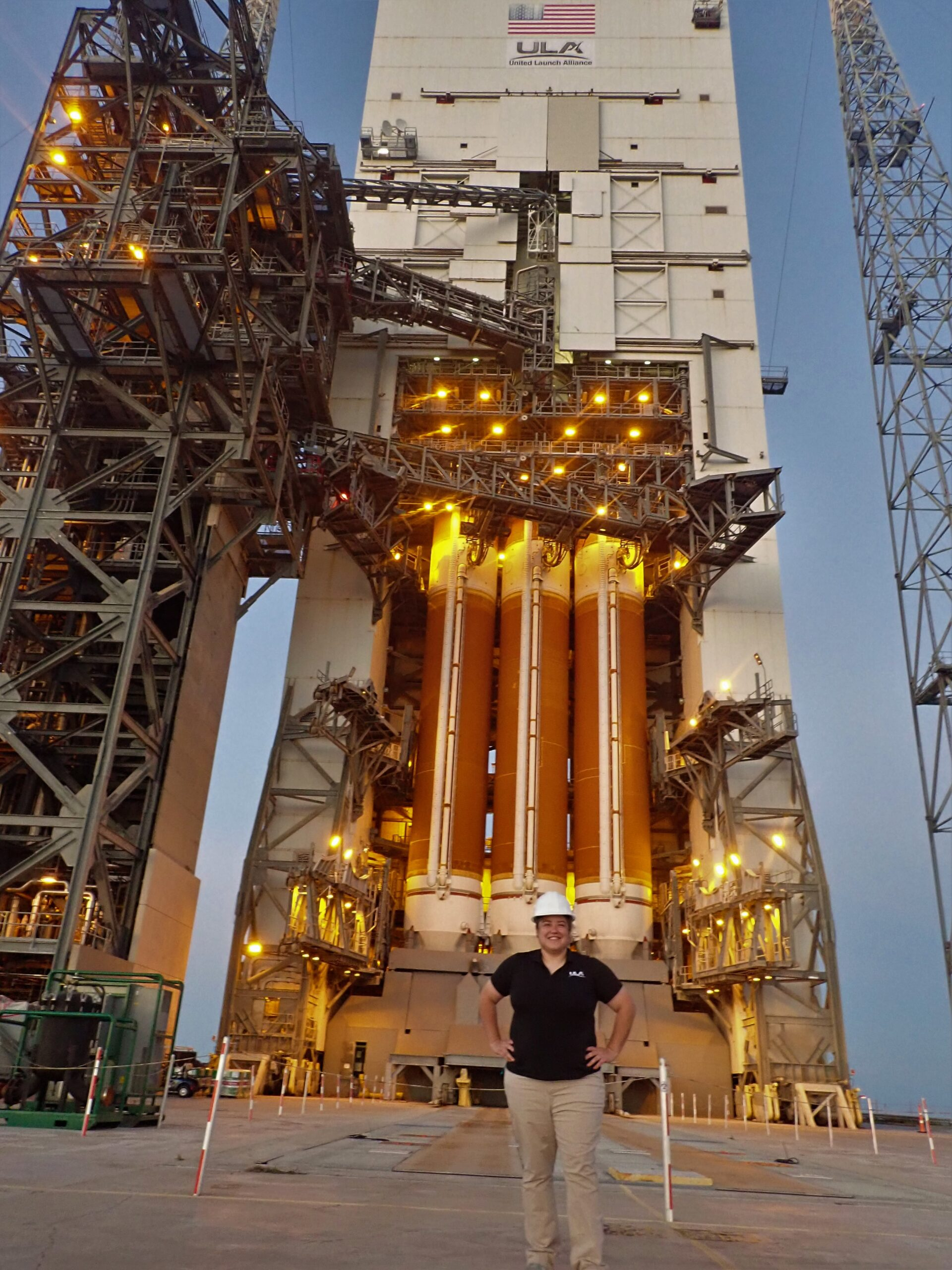 Adams visits the enormous Delta IV Heavy rocket on Space Launch Complex-37 during a recent trip to Cape Canaveral Air Force Station.