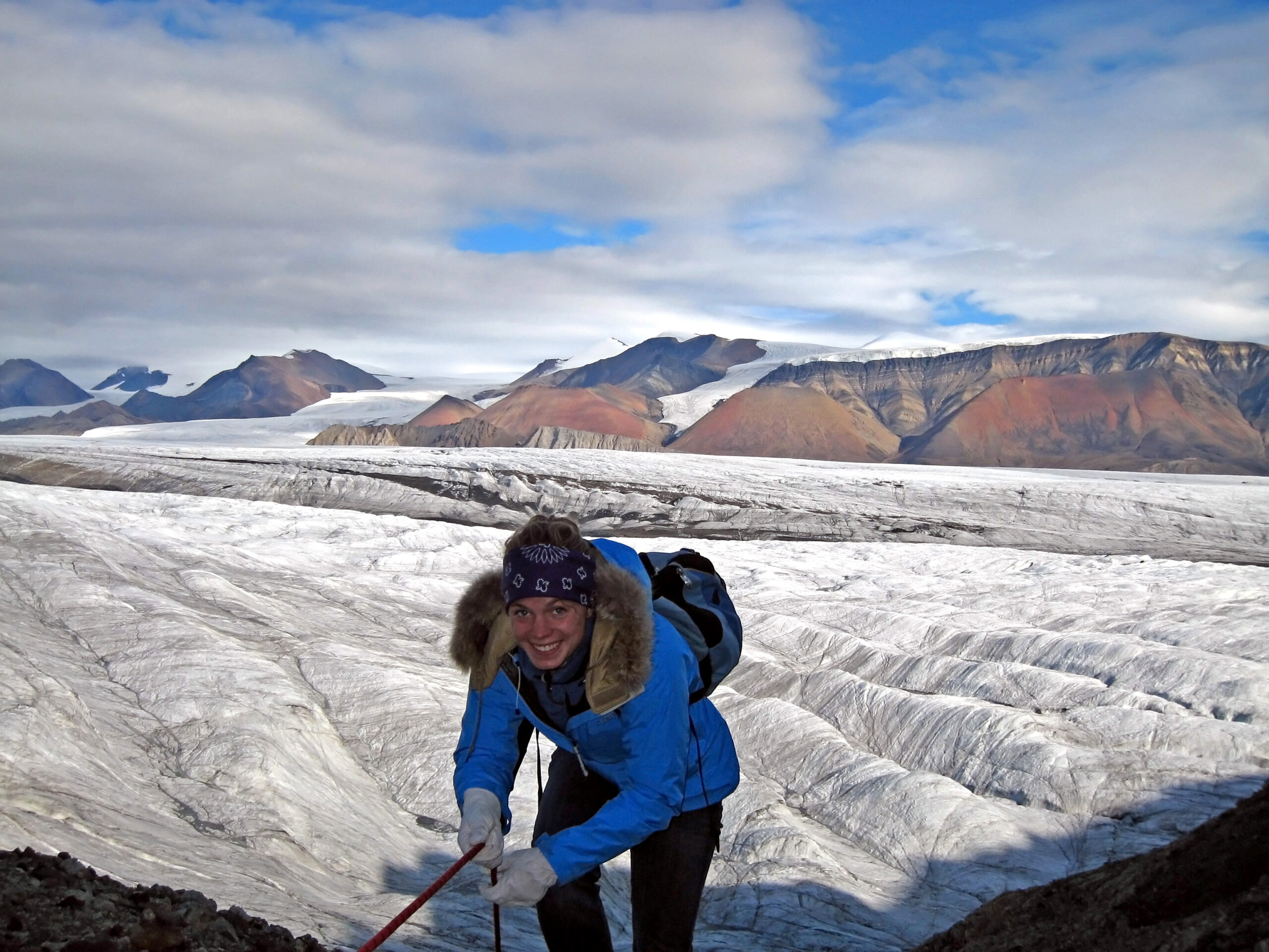 Zena Cardman smiles near a glacier.