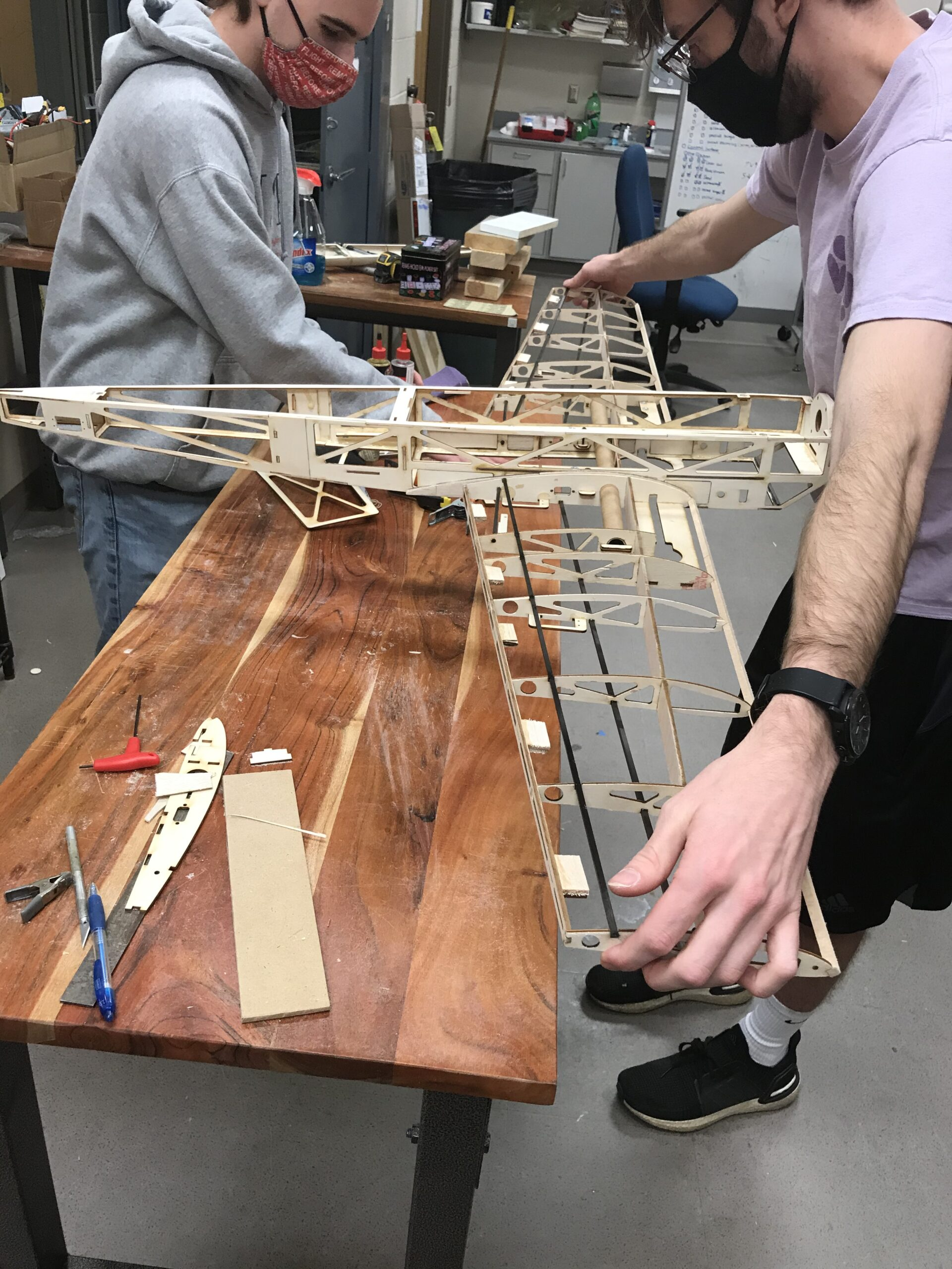 NC State AIAA team members construct the frame of their remote-controlled flyer, Airwolf, built for the 2021 AIAA Design, Build, Fly competition.