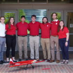 The NC State University American Institute of Aeronautics and Astronautics (AIAA) team showcases their remote-controlled flyer, Airwolf, built for the AIAA Design, Build, Fly competition.